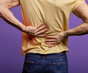 Man holding painful back