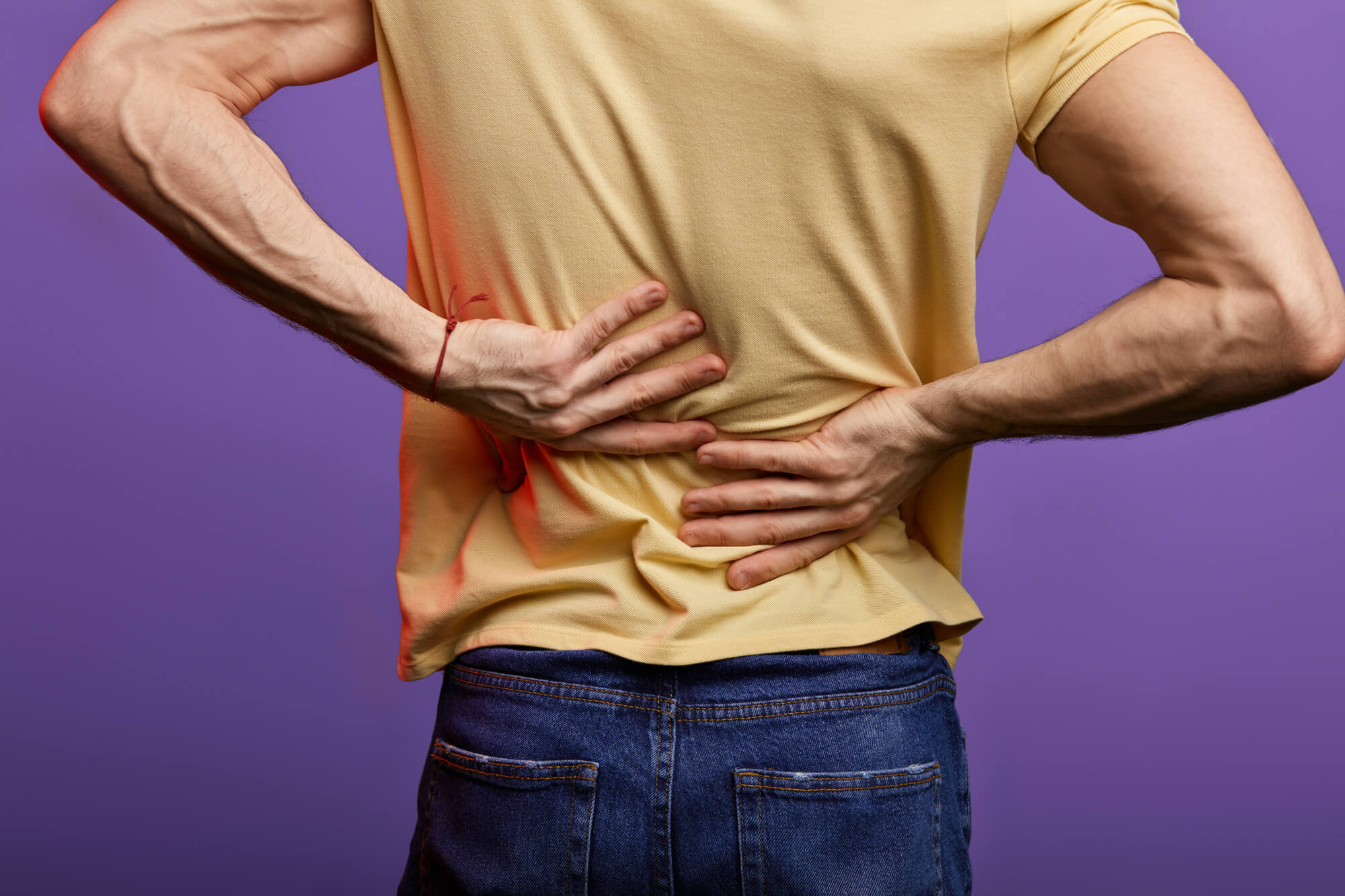 Man holding painful back
