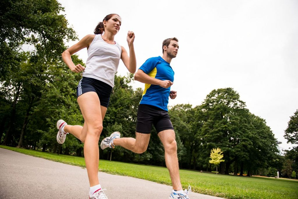 Two people fitness running, acupuncture supports health and fitness.