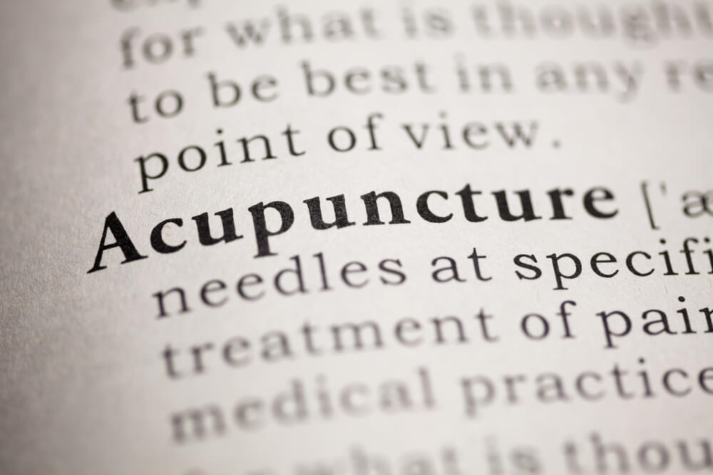 Page in book with word 'Acupuncture' in bold writing
